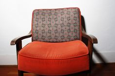 Or maybe this orange and printed combo chair — just the right accent to punch up your room a bit.