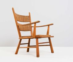 Unusual Solid Oak Armchair with Woven Cane Seat | From a unique collection of antique and modern lounge chairs at http://www.1stdibs.com/furniture/seating/lounge-chairs/