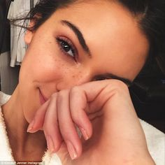Natural beauty: Kendall Jenner showed off her freckles on her flawless complexion on her I...