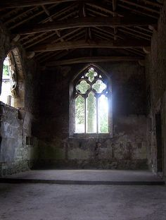The interior of the former chapel with the Bailey at Skipton Castle, showing large open Decorated window in the gable. When the chapel it was dedicated to St. John the Evangelist.
