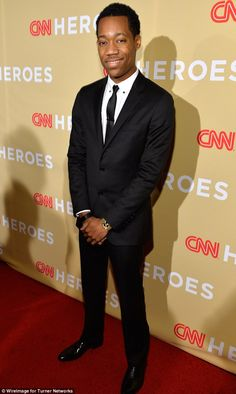 Handsome: Walking Dead actor Tyler James Williams looked sharp in a black suit with skinny...