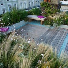 Roof garden in Holland Park By London garden designer Charlotte Rowe. This unusual house in Holland Park has a good sized roof for which there was permission for use as a roof terrace. The roof has wonderful views over the surrounding area and is open