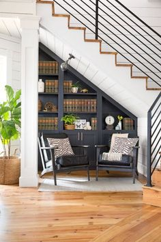"""""""The area under the stairs is often wasted space,"""" says Joanna. """"We transformed this spot— once a closet with book storage on one side—into a library nook, which feels perfect for a B&B. I always say 'Look beyond what's already there and make your home work for you.' """""""