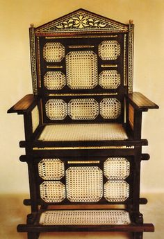 Kiti cha Enzi (Chair of Power), Carved from mahogany, with ivory inlay