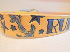 Nautical Yellow Leather Dog Collar with Tatto Font. $37.00, via Etsy.