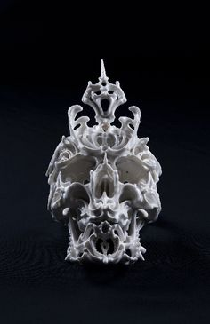 These porcelain skull sculptures by Katsuo Aoki are beautiful…intricately detailed and liquid-like…