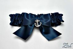 Garter single in navy blue with a navy blue satin bow and a silver anchor charm - Simply Satin. $17.99, via Etsy.