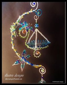 Bird feeder wire wrapped with dragonflies door illustrisdesigns