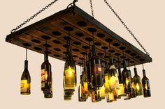 30 wine bottle light chandelier hanging from wood rack riddling riddling rack light fixture awesome aloadofball Images