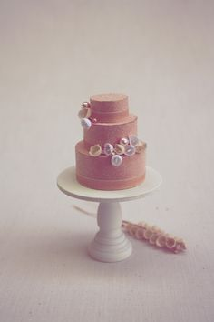 diy mini cake topper. A Field Journal. paper pastries trimmed with beaded icing and sugared with glitter crystal. link includes instructions and a list of materials needed