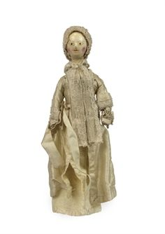 """Rare George II turned wood baby doll from the mid-18th century.  The faces on the """"child"""" dolls of this period look very adult to me."""
