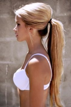 cute pony tail.Don't know why she is in a bra