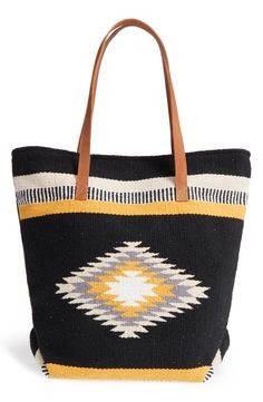 Bold geometric patterning makes this roomy woven tote stand out! It's also topped with comfortable over-the-shoulder handles for everyday use.