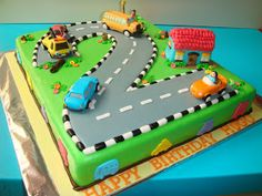 A 4.0kg car theme fondant chocolate cake with figurines (tow truck, bus, house etc..) for 2 years old lovely birthday boy.