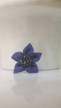 Check out this item in my Etsy shop https://www.etsy.com/listing/530895217/purple-handmade-kanzanshi-flower