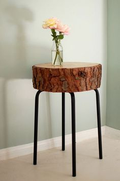 "$10 DIY from Apartment Therapy: $5.99 ""Marius"" stool from IKEA + elbow grease + time = super chic woodsy table."