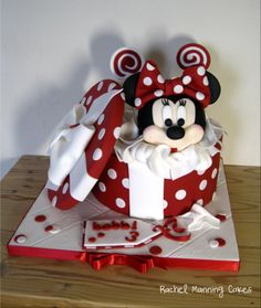 Minnie Mouse gift box cake - Minnies head is made form RCT https://www.facebook.com/photo.php?fbid=626423827407214&set=a.611723235543940.1073741833.202036236512644&type=1&theater