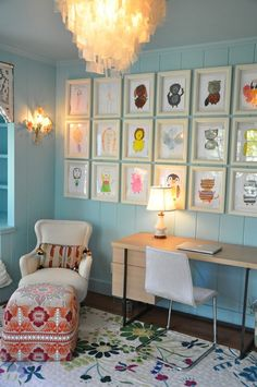 love this idea of displaying a child's drawings.  It would be so cute in a playroom!
