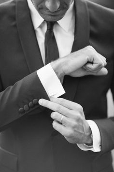 This is a great wedding photo to show off the men's ring and cuff links.