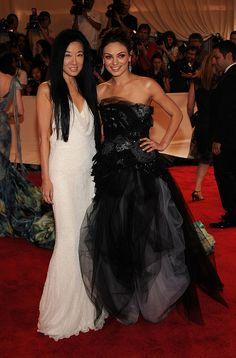 """NEW YORK - MAY 03: Designer Vera Wang (L) and actress Mila Kunis attend the Costume Institute Gala Benefit to celebrate the opening of the """"American Woman: Fashioning a National Identity"""" exhibition at The Metropolitan Museum of Art on May 3, 2010 in mg"""