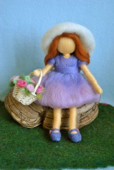 Waldorf inspired needle felted doll: The girl with hat and a basket of roses. $58.00, via Etsy.
