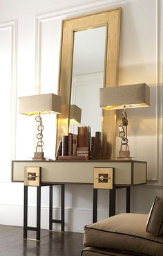 Architectural profile and geometric design ethos brass console table with matt black iron legs with details in dark and light burnished brass. Surface and sides in hand painted lacquered wood. Details and boxes in burnished brass. Brass mirror and console lamps available separately.