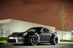 black 997 Turbo. Yum yum yum. Just once let me drive it!! Please,,,,,,,,,,,,turn the music up and hit the road! What a dream,,,,,,,