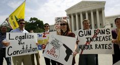 Pro rights guns supporters hold up their banners outside the Supreme Court in Washington, Thursday, June 26, 2008, after the court ruled that Americans have a constitutional right to keep guns in their homes for self-defense, the justices' first major pronouncement on gun control in U.S. history.  - (AP Photo/Jose Luis Magana)