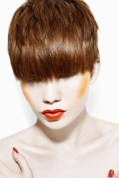 Short Straight Layered Haircut with Reddish highlights