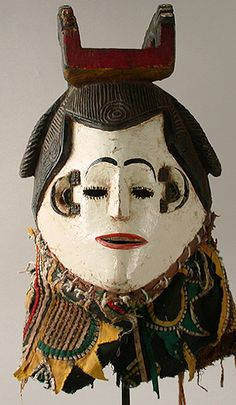 Igbo helmet mask from Eastern Nigeria, Africa.  I like this mask as it looks like a lady with red lipstick and eyelashes.  Thats how I draw eyelashes.