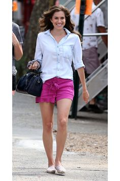 Allison Williams in chambray shirt, purple shorts, & Soludos espadrilles