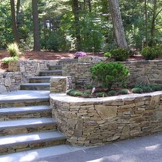Stone retaining wall in backyard - even though I don't like moving rocks I am sure I will be doing a lot with rocks when I have my own place =)