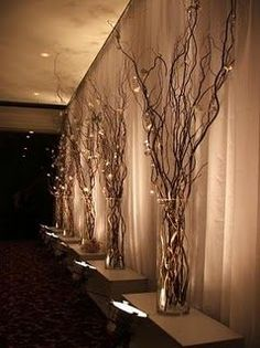 These lighted branches are absolutely stunning! Great or centerpieces or place these branches among your houseplants and let their soft light permeate throughout the room. They feature five natural wi wedding lights lighted branches Branches Allumées, Willow Branches, Branches With Lights, Painted Branches, Dream Wedding, Wedding Day, Trendy Wedding, Chic Wedding, Wedding Table