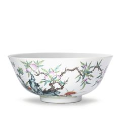 A LARGE FAMILLE-ROSE 'PEACH' BOWL SEAL MARK AND PERIOD OF DAOGUANG well potted with deep rounded sides resting on a short foot, the exterior delicately painted with a continuous scene depicting gnarled and overhanging branches issuing clusters of peaches and leaves next to lingzhi blooms and jagged rockwork, the tranquil scene detailed with lotus leaves, buds and blooms issuing from a pond, all picked out in soft shaded tones of pastel enamels, the base inscribed in underglaze blue with a…
