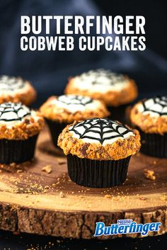 Looking for a tasty web to weave? Dress up the treats at your costume party with these easy to make Cobweb Cupcakes. Featuring a kick of crunchy Butterfinger crumbles, our sweet spider cupcakes are always a Halloween favorite. Köstliche Desserts, Holiday Desserts, Holiday Treats, Delicious Desserts, Yummy Food, Cupcake Recipes, Cupcake Cakes, Dessert Recipes, Party Cupcakes