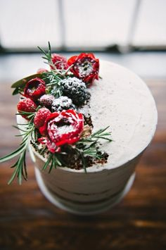 the two-tiered nearly naked choc cake could have blooms, blackberries/blueberries/and even cherries to one far side on top and then a similar cluster in between layers on the opposing side. rosemary or eucalyptus to accent