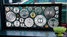 FOUND OBJECT WINDOW : Another in the found object series and I wanted to try and use a lot of larger platters mixed with smaller objects.