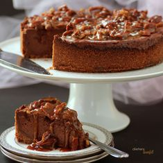 Chocolate Cheesecake with homemade graham cracker crust and finished with sweet Praline Topping.