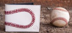 On Sale Genuine Baseball Wallet Made from Genuine Baseball Leather with Real Red Stitching. Makes a great gift for coaches fathers, sons, and Baseball Fans. Purchase at http://woodbats4sale.com