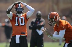 Cleveland Browns quarterback Robert Griffin III, left, takes a break as he watches quarterback Austin Davis take a snap during practice at the NFL football team's training camp facility, Wednesday, May 18, 2016, in Berea, Ohio. (3396×2252)