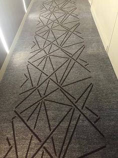 Hotel hallway. Notice that there's a carpet runner with pattern down the middle - great for camouflaging dirt and stains.