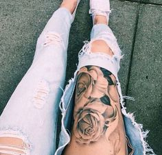 Lower thigh flower tattoo.