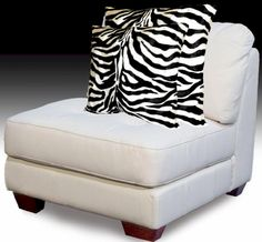"Zebra Wild Instinct Pillow  Zebra pillow that is Elegant and soft to the touch. The Zebra print is stunning, with a white background with black zebra stripes, that include the realistic main.     The fashion faux fur is approximately 1/8"" pile, for a soft smooth feel. Nice accent for any decor from formal to modern. None-removable Cover. Damp Cloth Cleaning.   Available sizes, 19""x19"" Toss pillow, 19"" x 12"" Oblong.  $24.00-$29.99  SALE $15.00-$23.00"