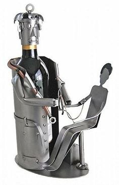 Doctor with Patient Wine Bottle Holder / Caddy / Caddie by H&K Steel. $94.99. Doctor with Patient Wine Bottle Caddie. This Doctor with Patient Wine Bottle Holder / Caddy makes for a fantastic & unique gift for any medical doctor! Holds a 750ml wine bottle. * Wine bottle not included. These original sculptures were first brought to the United States in 1997. Since their introduction the collection has been carefully redesigned to reflect the American lifestyle and sense of ...