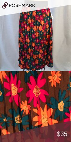Skirt Soft pleated Lularoe Jill skirt with brown background , pink, orange and aqua floral print and black elastic waist band. 100% polyester. LuLaRoe Skirts Midi