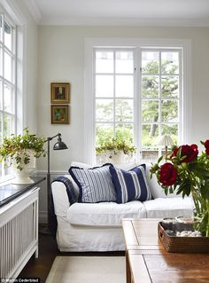 In the living room, Kristina wanted to create not only a functional space but also one in which to relax with family and friends. 'I change cushions and throws every season, adding coastal-inspired pieces and shades of blue to create a light atmosphere in summer and chunky-knit accessories in deeper shades for winter.' The cushions are all from Lexington. For a similar sofa try Sofa.com