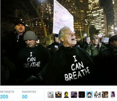 """Supporters of the New York Police Department marched in the streets Friday night wearing black hoodies with the phrase """"I can breathe, thanks to the NYPD."""""""