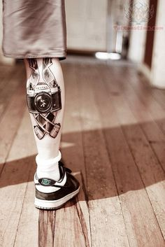 film strip tattoos | Camera And Film Tattoo On Calf