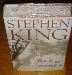 Bag of Bones by Stephen King 1998 Hardcover Brand New Sealed in Plastic Wrap  Here is  Stephen King most gripping and unforgettable novel -- First Edition Release Date: September, 1998  A tale of grief and lost love's enduring bonds, of haunting secrets of the past, and of an innocent child caught in a terrible crossfire. It is no secret that King is one of our most mesmerizing storytellers. In Bag of Bones, he proves to be one of our most moving as well.