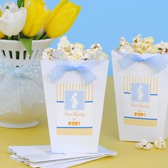 "Prepping for a baby shower for a mom-to-be who's ""Ready to Pop?"" These inexpensive party favors are simple to make and will delight your guests. All you'll need:  •Pretty ribbon •Boxes from your local party store •Custom 3""x2"" labels from Bottle Your Brand  *Popcorn not included ;)"